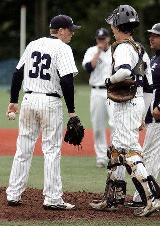 KEN YUSZKUS/Staff photo. St. John's Prep pitcher Evan Roberts has a conversation on the pitcher's mound at the top of the 7th inning during the Lowell at St. John's Prep in the first round of the Super 8 baseball state playoffs. 5/28/14.