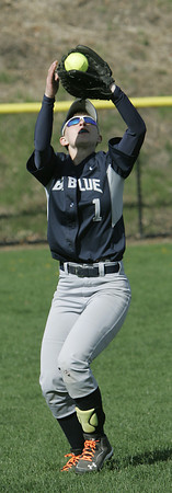 KEN YUSZKUS/Staff photo.  Swampscott's Tori Thistle catches a pop fly during the Danvers at Swampscott softball game.      5/7/14