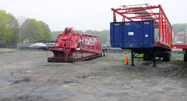 KEN YUSZKUS/Staff photo. Parts of a crane are parked on the land near where the new senior citizens will be built in Salem.         5/9/14