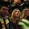 Salem State University graduates look up at one of the big screens to watch and listen to remarks made by fellow graduate Bianca Carreiro on Saturday afternoon. DAVID LE/Staff photo. 5/18/14.