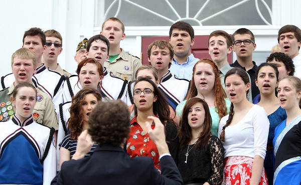 The Danvers High School chamber singers perform God Bless America on the steps on Danvers Town Hall on Monday morning. DAVID LE/Staff photo. 5/26/14.