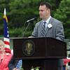 KEN YUSZKUS/Staff photo. Peabody Mayor Ed Bettencourt speaks at the Peabody Veterans Memorial High School graduation.   5/30/14.
