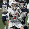 KEN YUSZKUS/Staff photo. Masco's Cam Jung keeps possession of the ball with Hamilton-Wenham's Lattanzi fighting for the ball during the Hamilton-Wenham at Masconomet boys lacrosse game.   5/6/14
