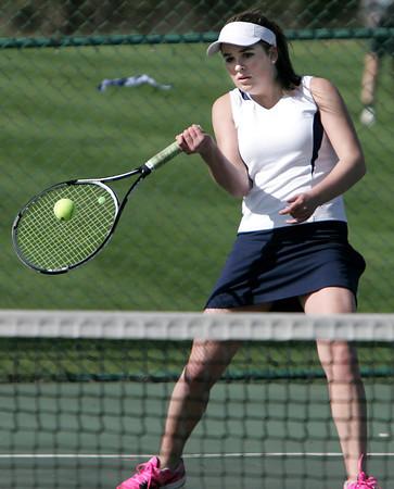 KEN YUSZKUS/Staff photo. Peabody's singles player Kayla Hodas competes during the Peabody at Danvers girls tennis match.       5/5/14
