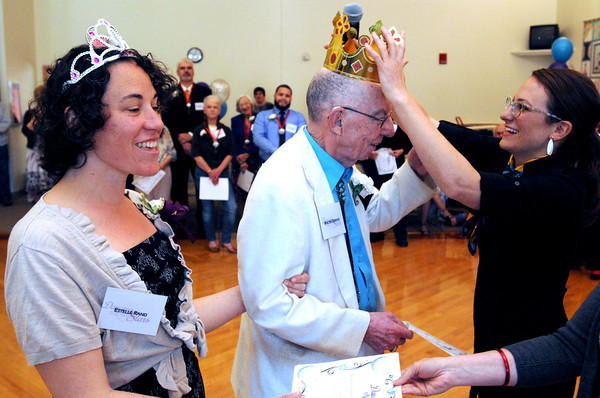 KEN YUSZKUS/Staff photo. Crowned for winning 1st place, are Beverly City Councilor, Ward 2, Estelle Rand and her partner Walter Osgood at the Dancing with the Stars competition held at the Beverly Senior Center. Crowning the couple is activities director Annie Wright.     5/20/14