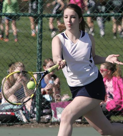 KEN YUSZKUS/Staff photo. Peabody singles player Rachel Gillis returns the ball during the Peabody at Danvers girls tennis match.       5/5/14
