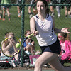 KEN YUSZKUS/Staff photo. Peabody singles player Rachel Gillis returns the ball during the Peabody at Danvers girls tennis match.       5/5/14