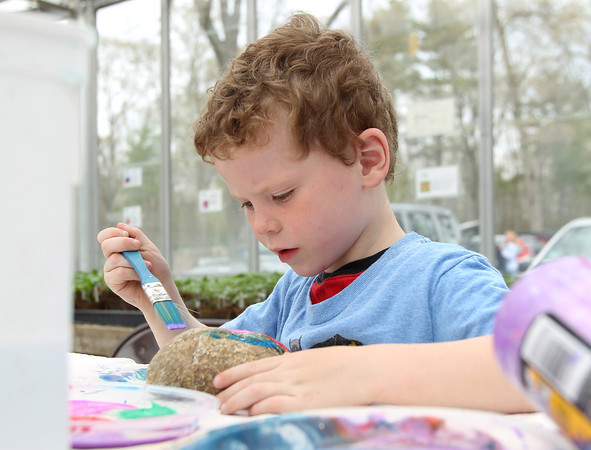 Five-year-old Wyatt Phillips paints a rock at Meet the Animals Day at Green Meadows Farm in Hamilton on Saturday afternoon. DAVID LE/Staff photo. 5/10/14