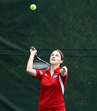 Salem junior Jessi Tassineri serves against Swampscott during first doubles play on Tuesday afternoon. DAVID LE/Staff photo. 5/13/14.