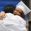 KEN YUSZKUS/Staff photo. Ajah Joseph, left, gets hugged by Jaydi Labbe as students assemble in the gym before the Peabody Veterans Memorial High School graduation.   5/30/14.