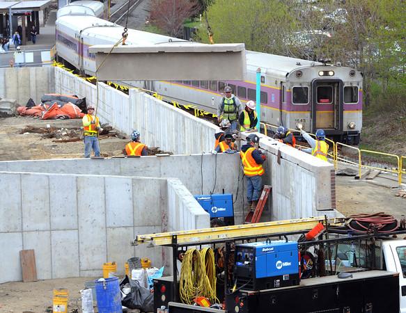 KEN YUSZKUS/Staff photo. The next phase of construction begins on the MBTA garage in Salem.        5/5/14