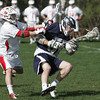KEN YUSZKUS/Staff photo. Masco's Stephen Pease batts ball carrying Hamilton-Wenham's Ecker during the Hamilton-Wenham at Masconomet boys lacrosse game.   5/6/14