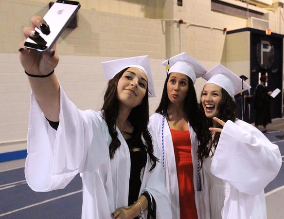 KEN YUSZKUS/Staff photo. From left, Jillian DiFelice takes a selfie with Veliotta Fabrikarakis and Jillian Rubin before lining up for the procession of the Peabody Veterans Memorial High School graduation.   5/30/14.