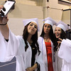 KEN YUSZKUS/Staff photo. From left, Jillian DiFelice takes a selfie with Veliotta Fabrikarakis and Jillian Rubin before lining up for the procession of the Peabody Veterans Memorial High School graduation.   5/30/14.