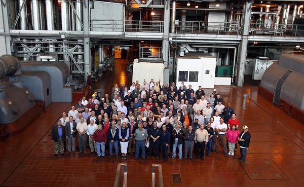 Past and present employees at the Salem Power Plant take a group photo during a final worker barbecue on Thursday afternoon. David Le/Staff Photo. 5/16/14.