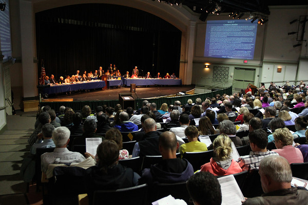 Hundreds to people packed into the auditorium at Ipswich High School for the Town Meeting, and many others were forced to watch the proceedings from a side room as the whole auditorium was packed. DAVID LE/Staff photo. 5/13/14.