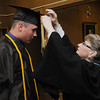 KEN YUSZKUS/Staff Photo. Grad James Traversy has Sister Geraldine help by adding the tassle before the start of the Bishop Fenwick graduation.  5/23/14.