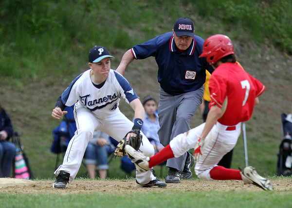 Peabody third baseman Bobby Tramondozzi (4) reaches out to put the tag on a sliding Everett runner after getting the throw from shortstop Ryan Collins. DAVID LE/Staff photo. 5/26/14.