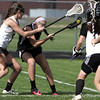 KEN YUSZKUS/Staff photo. Ipswich Marley Henderson squeezes Bishop Fenwick's Caroline Crawford who has a shot at the net, but Ipswich goalie Eliza Statile, right, is in her way as well during the Bishop Fenwick at Ipswich High girls lacrosse North Division 2 quarterfinal playoff game.  5/29/14.