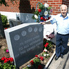 Dominic Carnevale, a 92-year-old World War II veteran and founding member of the Vittori-Rocci Post on Brimbal Ave in Beverly has planted flower in two cement urns outside the Post every Memorial Day. This year, someone stole the two urns from in front of Rocci Post before the Memorial Day weekend. DAVID LE/Staff photo. 5/30/14.