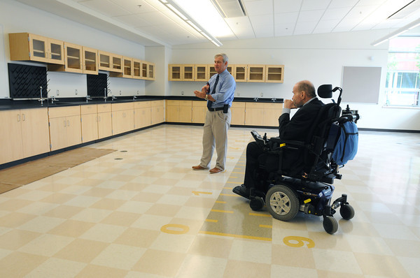 KEN YUSZKUS/Staff photo. Superintendent of Essex Tech Dan O'Connell, left, speaks about one of the science labs they are in at the new Essex Tech with former Sen. Fred Berry on the right.      5/20/14
