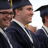 St. John's Prep Salutatorian Conor Sweeney smiles while listening to Valedictorian Alec McNiff's address during Commencement on Sunday afternoon at Ryken Field in Danvers. DAVID LE/Staff photo. 5/18/14.