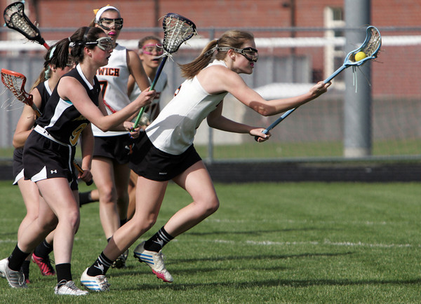 KEN YUSZKUS/Staff photo. Ipswich Meghan Lindahl has the ball and is closely followed during the Bishop Fenwick at Ipswich High girls lacrosse North Division 2 quarterfinal playoff game.  5/29/14.