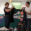 Bridget Ayers, 15, and Samuel Martin, both of Salem, sort through clothes donations made for those affected by the Dow St. fire which displaced 45 people. DAVID LE/Staff photo. 5/10/14
