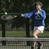 KEN YUSZKUS/Staff photo.   Danvers' doubles player Rhianna Leslie sends one back during the Swampscott at Danvers girls tennis match.    5/8/15