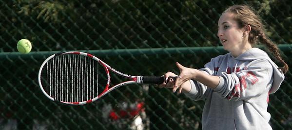 KEN YUSZKUS/Staff photo.   Swampscott's doubles player Michelle Shnayder belts one back during the Swampscott at Danvers girls tennis match.    5/8/15