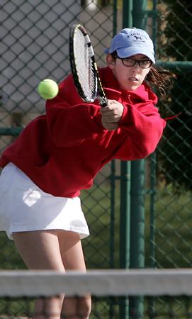 KEN YUSZKUS/Staff photo.   Danvers' singles player Rachel Leslie hits one back during the Swampscott at Danvers girls tennis match.    5/8/15