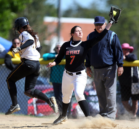 DAVID LE/Staff photo. 5/23/15. Bishop Fenwick senior captain Jenny Nasser reaches first safely with an infield hit as Beverly senior Emily Pitman stretches to snag a throw.