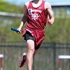 DAVID LE/Staff photo. 5/23/15. Gloucester 4x800 relay runner Troy Ciarametaro turns the first corner.