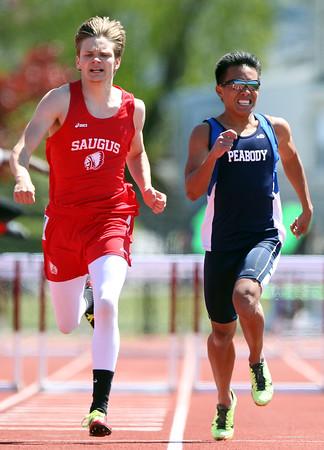 DAVID LE/Staff photo. 5/23/15. Saugus' Alex Kotkowski, left, edges out Peabody senior Christian Cedullo in the boys 400 meter hurdles.