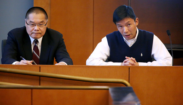 KEN YUSZKUS/Staff photo.    Sifa Lee, right, answers his attorney's questions while on the stand during his murder case at Salem Superior Court. Interpreter Way Moy is to the left.   05/12/16