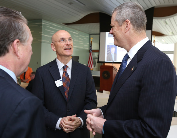 KEN YUSZKUS/Staff photo.     Gov. Charlie Baker, right, talks with Salem State University associate provost and dean Neal DeChillo when he arrives to speak to the North Shore Alliance for Economic Development at Salem State University Tuesday morning.     05/17/16
