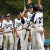 DAVID LE/Staff photo. Peabody junior Nick Palma is greeted after scoring his second run of the game against Bishop Fenwick. 5/30/16.