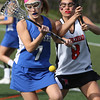KEN YUSZKUS/Staff photo.   Danvers' Annie Tarricone, left, and Marblehead's Carolyn Arthur go after the loose ball during the Danvers at Marblehead girls lacrosse game at Marblehead High School.     05/16/16