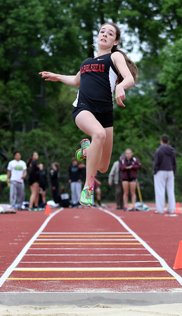 DAVID LE/Staff photo. Marblehead sophomore Sarah Caulfield flies through the air during the long jump against Gloucester on Tuesday afternoon in a meet to determine the NEC Conference champions. 5/24/16.
