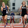 DAVID LE/Staff photo. Salem junior Dani Stotts, right, edges out Peabody junior Teya Marquis, left, 1:10.09 to 1:10.84 to capture second in the 400 meter hurdles at the NEC Conference Meet. 5/21/16.