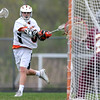 DAVID LE/Staff photo. Ipswich sophomore attack Kevin Swenson (3) rifles a shot past Newburyport goalie Tyson Gudaitis, right, for his eighth goal of the game, leading the Tigers to a 16-9 victory. 5/13/16.