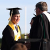 DAVID LE/Staff photo. Bishop Fenwick graduate and Bishop Benedict Joseph Fenwick Award recipient Matthew Loehle shakes hands with Br. Thomas Zoppo while receiving his diploma on Friday evening. 5/20/16.
