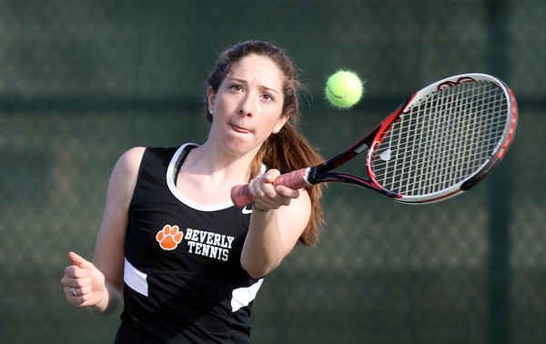 DAVID LE/Staff photo. Beverly senior captain and first singles player Carly Blau returns a volley in the Panthers' match versus Winthrop on Thursday afternoon. 5/19/16.