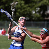 KEN YUSZKUS/Staff photo.          Danvers' Olivia Heutlinger, left, passes to a teammate during the Wakefield at Danvers girls lacrosse tournament game.            05/31/16