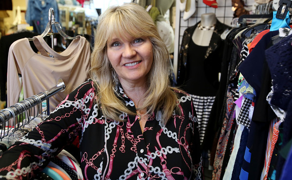 KEN YUSZKUS/Staff photo.     Kim Weaver is the owner of the Golden Hanger consignment shop in Beverly.    04/28/16