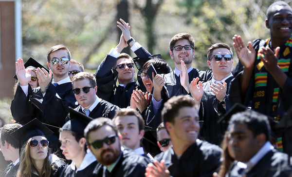 DAVID LE/Staff photo. Gordon College graduates stand up and cheer for their professors at Commencement on Saturday morning. 5/14/16.