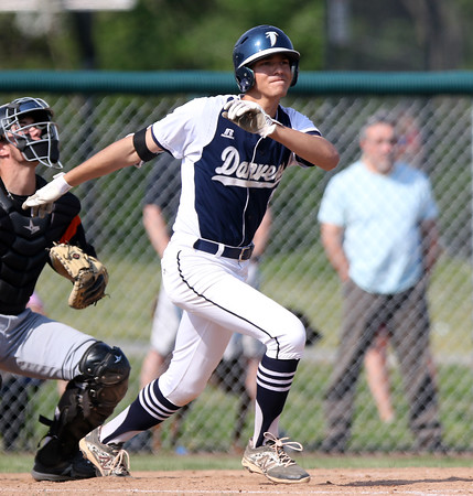 DAVID LE/Staff photo. Danvers sophomore Tommy Mento tracks the flight of his two-RBI double in the first inning to stake the Falcons to a 3-0 lead against Beverly in a game for the NEC Championship. 5/27/16.