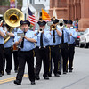 DAVID LE/Staff photo. A marching band parades down Cabot Street while playing military tunes as part of the annual Beverly Memorial Day Parade on Monday. 5/30/16.