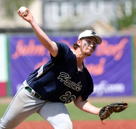 DAVID LE/Staff photo. Essex Tech starting pitcher JT Reynolds fires a pitch against Danvers on Saturday afternoon. 5/14/16.