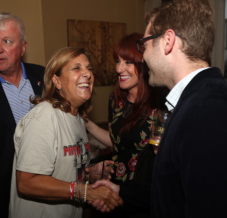 DAVID LE/Staff photo. Nancy Frates, mother of Pete Frates, shakes hands and chats with Nicholas Brindamour, right, and Vanessa Kelley, at Pints for Pete, held at the Wild Horse Cafe in Beverly on Thursday. 5/5/16.